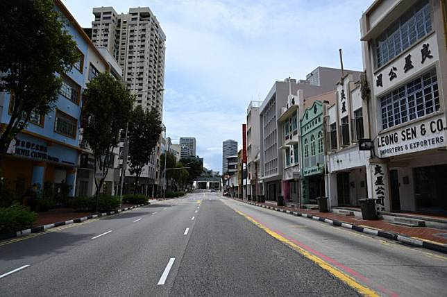An empty street is pictured during restrictions put in place to halt the spread of the COVID-19 coronavirus in the central business district in Singapore on May 22, 2020.