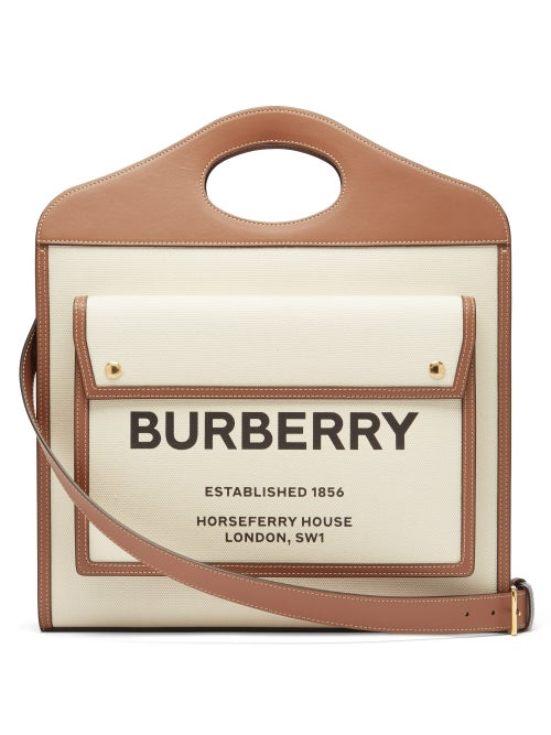 Burberry - Inspired by a silhouette from the house's storied archives, Burberry's ivory Pocket bag i