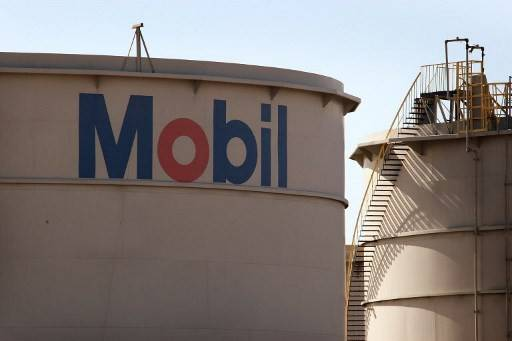 A Mobil logo is painted on a storage tank at the Exxon Mobil refinery 01 November, 2007 in Joliet, Illinois.