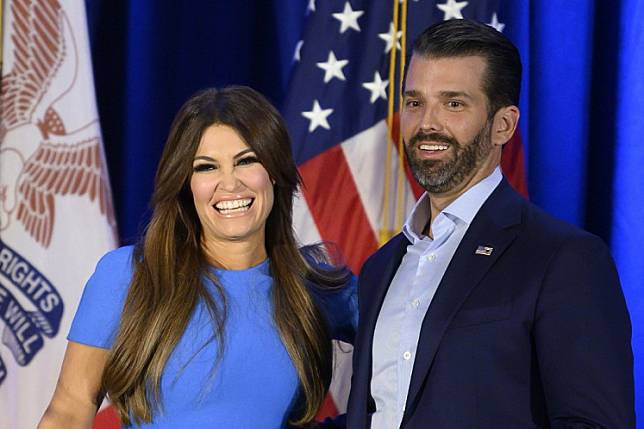 In this file photo taken on Feb. 3 Donald Trump Jr. (R) and his girlfriend Kimberly Guilfoyle smile during a