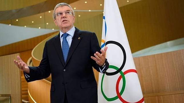 Presiden IOC (Komite Olimpiade Internasional) Thomas Bach. [AFP/Fabrice Coffrini]