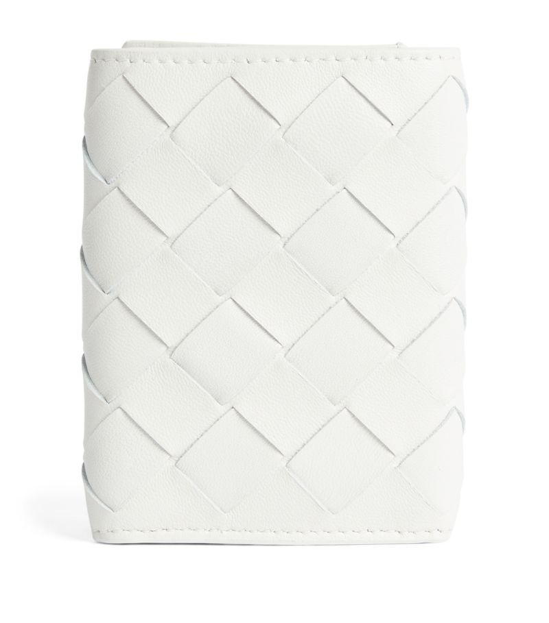 Eschew volatile trends and stick to meticulously designed staples with Bottega Veneta's elegant line-up of accessories, which includes this exquisite mini leather wallet. Instantly recognisable through the iconic Intrecciato weave, the slim design boasts card slots and a handy coin pocket so you can carry your monetary essentials safely and effortlessly.