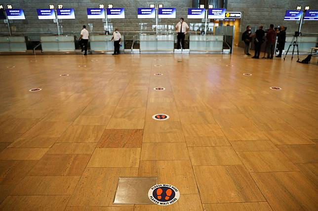 A social distancing marker is seen on the floor at the departures terminal as Israel's airport authority announced a pilot program revealing what passengers leaving Israel should accept as air travel gradually returns to normal after weeks of bare minimum flights due to the COVID-19 outbreak, at Ben Gurion International Airport, in Lod, near Tel Aviv, Israel May 14, 2020. Israel is seeking to export lessons that have allowed it to emerge as one of the least-hit victims of the pandemic.