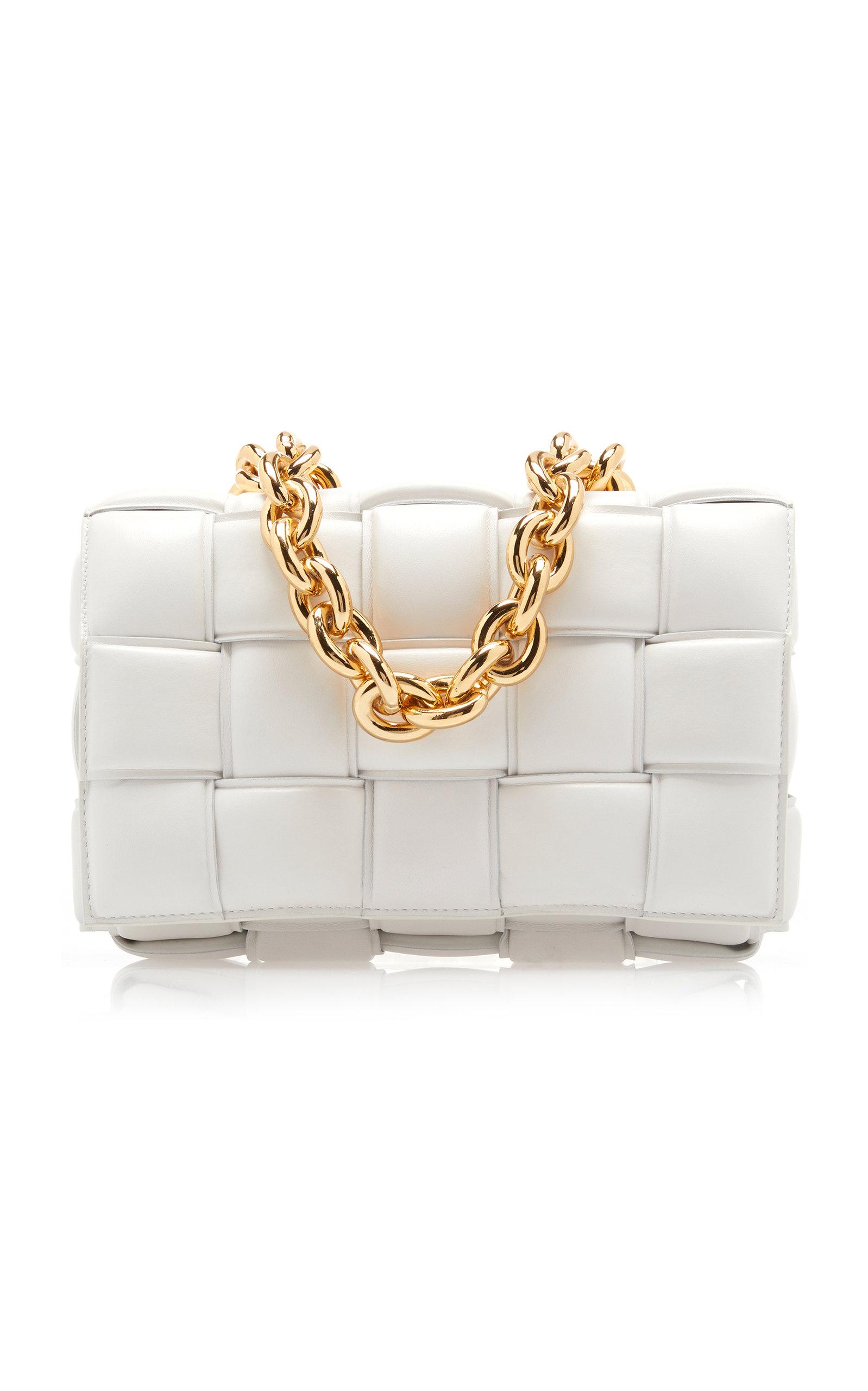 Woven using Bottega Veneta's distinguished intrecciato technique, this creamy white crossbody bag is