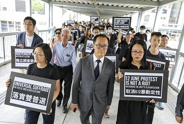 Thousands of Hong Kong accountants join protest march - despite pleas from employers and promise of free lunches