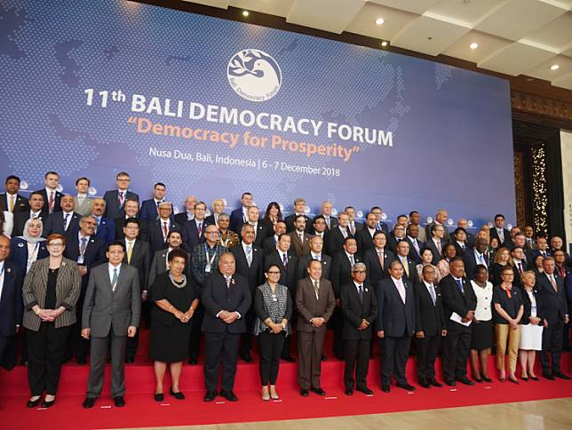 Indonesian Foreign Minister Retno LP Marsudi takes a group photo with participants of the 2018 Bali Democracy Forum in Nusa Dua, Bali on Dec. 6, 2018.