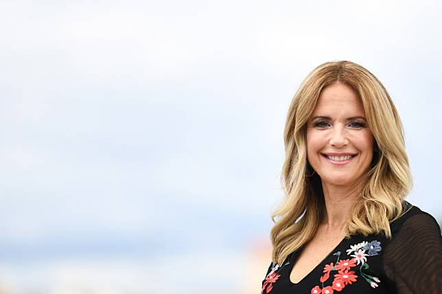 In this file photo taken on May 15, 2018 US actress Kelly Preston poses during a photocall for the film 'Gotti' at the 71st edition of the Cannes Film Festival in Cannes, southern France.