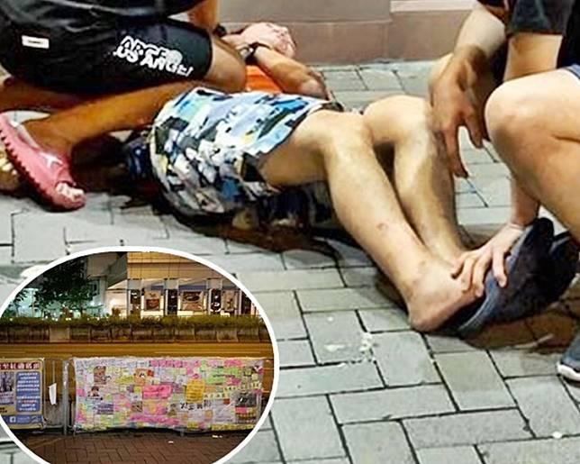 男子意外跌倒。小圖為 德民街的「連儂Banner」。網圖