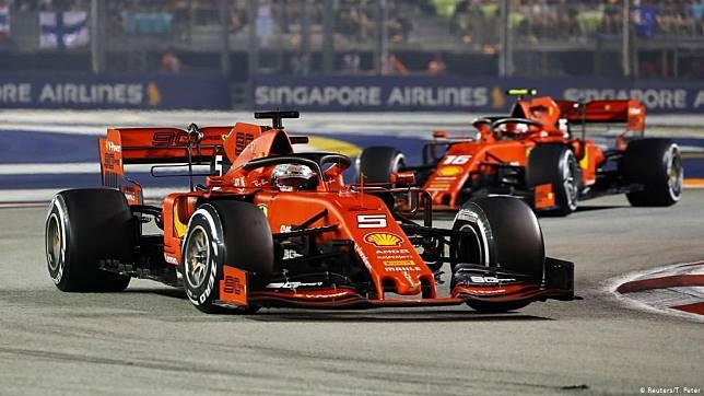 Sebastian Vettel menang F1 Singapura