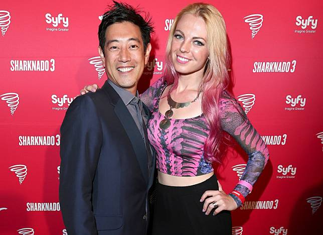 TV personality Grant Imahara (L) and Jenny Newman attend the 'Sharknado 3' Party during Comic-Con International 2015 at Hotel Solamar on July 10, 2015 in San Diego, California.