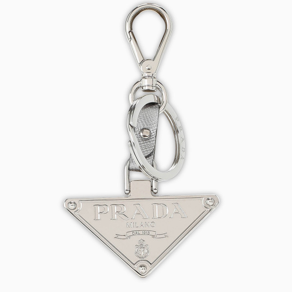 Keychains by Prada in silver-tone metal featuring logo triangle pendant. Fall/Winter 2020-21 collection.