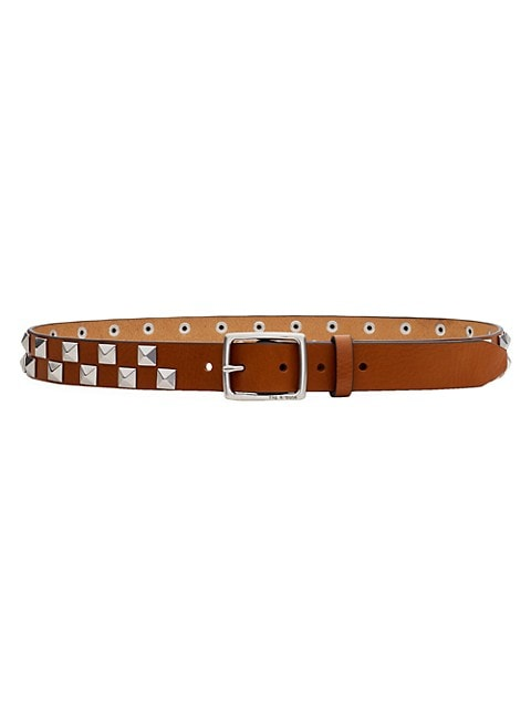 Leather belt with grommet detail.; Adustable buckle; Silvertone hardware; Grommet detail; Leather; I