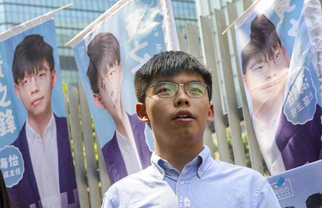 Hong Kong pro-democracy leader Joshua Wong and others arrange backup candidates to contest district council elections