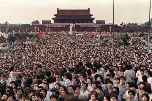 his file photo taken on June 2, 1989 shows people gathered at Tiananmen Square during a pro-democracy protest in Beijing. After seven weeks of protests by students and workers demanding democratic changes and the end of corruption, soldiers and tanks chased and killed demonstrators and onlookers in the streets leading to the square. But 30 years after the killings of June 4, 1989, the government still keeps a lid on what really happened and how many died on that fateful day.
