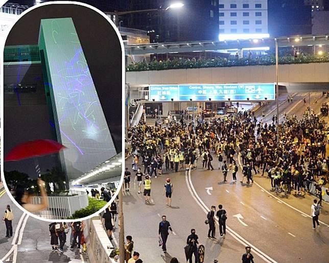 示威者在集會後,逗留在金鐘一帶的馬路。小圖為示威者以鐳射光線照向政府總部。