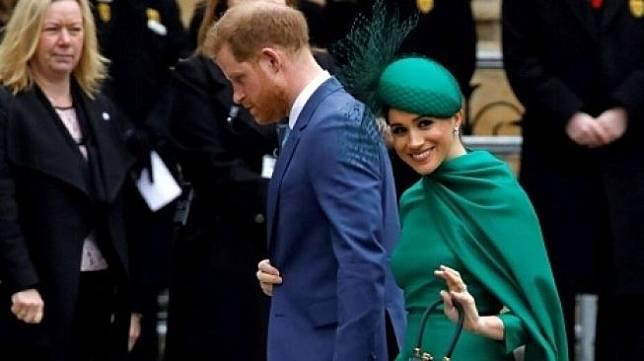 Pangeran Harry dan Meghan Markle saat menjalankan tugas terakhir sebagai anggota senior keluarga Kerajaan Inggris. (Foto: Tolga Akmen/AFP)
