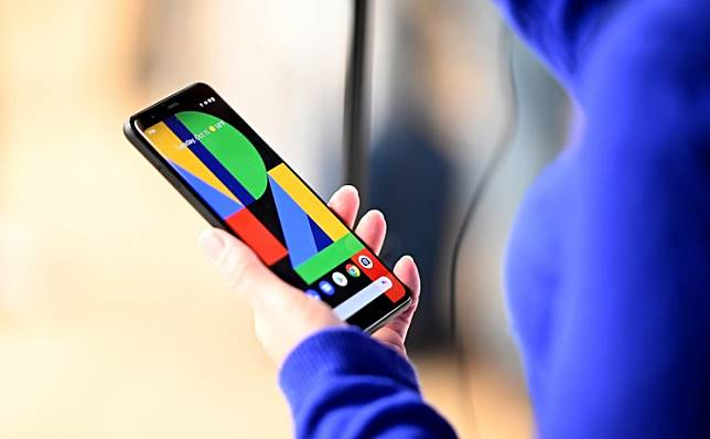 A woman holds the Google Pixel 4 phone during a Google product launch event called 'Made by Google 19' in New York City on October 15, 2019. Google unveiled its newest Pixel handsets, aiming to boost its smartphone market share with features including gesture recognition that lets users simply wave their hands to get things done.