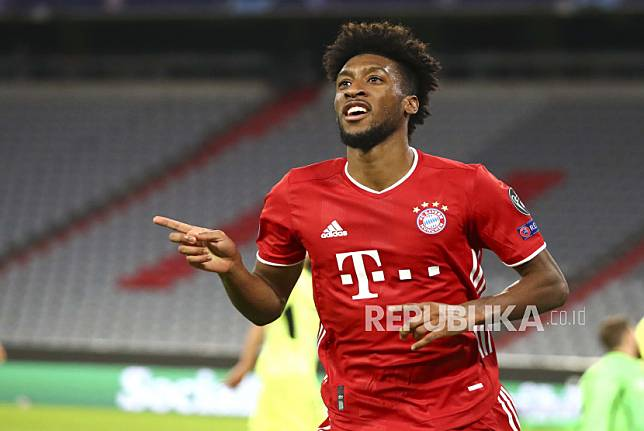Bayern Munichs Kingsley Coman celebrates after scoring his teams fourth goal during the Champions League Group A soccer match between Bayern Munich and Atletico Madrid at the Allianz Arena in Munich, Germany, Wednesday, Oct. 21, 2020. (AP Photo/Matthias Schrader,Pool)