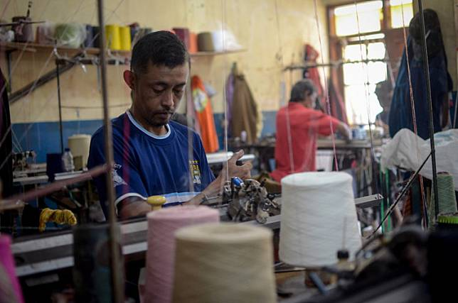 Workers produce knitwear at the Rajong Binong Jati Center, Bandung, West Java, on March 6, 2020.