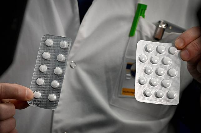 Medical staff shows on February 26, 2020 at the IHU Mediterranee Infection Institute in Marseille, packets of a Nivaquine, tablets containing chloroquine and Plaqueril, tablets containing hydroxychloroquine, drugs that has shown signs of effectiveness against coronavirus.