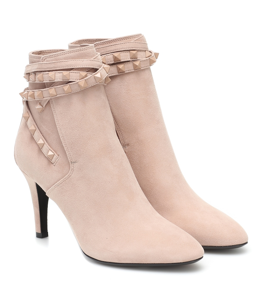 Valentino Garavani's Flair suede boots have been made from plush powder pink suede, and adorned with