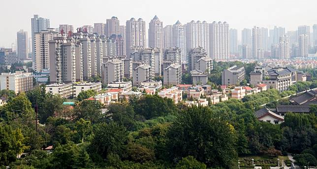 Xian, the city with the fastest rising home prices in China, imposes property buying curbs on immigrants