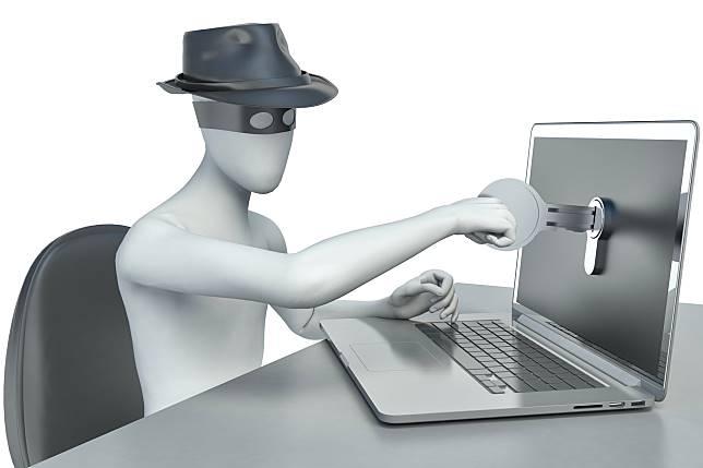 3d man hacker, stealing data from a laptop