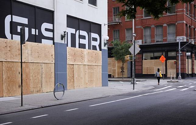 Damaged and boarded up storefronts are seen after protests against the death in Minneapolis police custody of George Floyd, in Manhattan