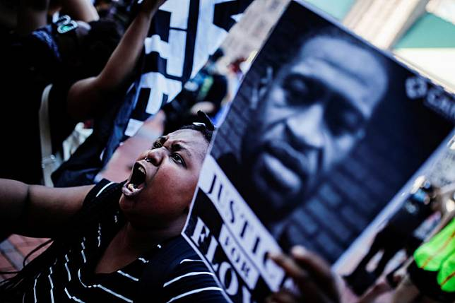 A protester reacts while gathering with others outside the city hall after a white police officer was caught on a bystander's video pressing his knee into the neck of African-American man George Floyd, who later died at a hospital, in Minneapolis, Minnesota, US, on May 28, 2020.