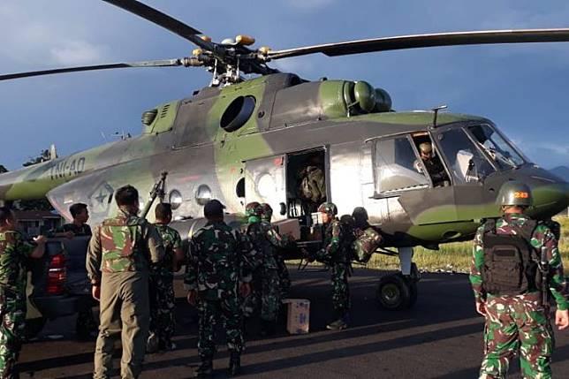 Helikopter milik TNI yang digunakan untuk mengevakuasi para korban pekerja di Nduga, Papua. (ISTIMEWA)   Artikel ini telah tayang di Kompas.com dengan judul