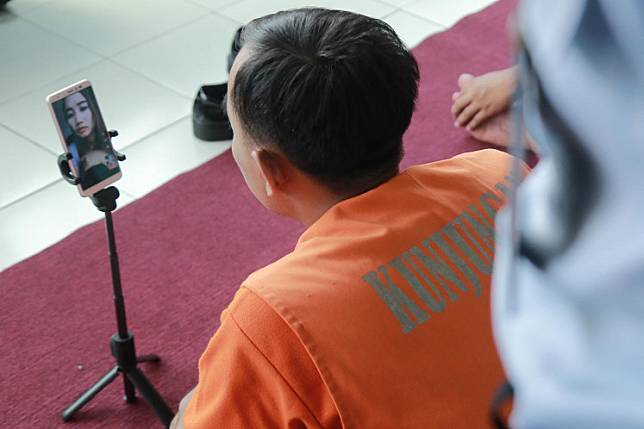 This picture taken on March 17 shows an inmate speaking to his family via video call at a prison in Blitar, East Java, after visits were stopped for two weeks amid concerns over the COVID-19 outbreak.