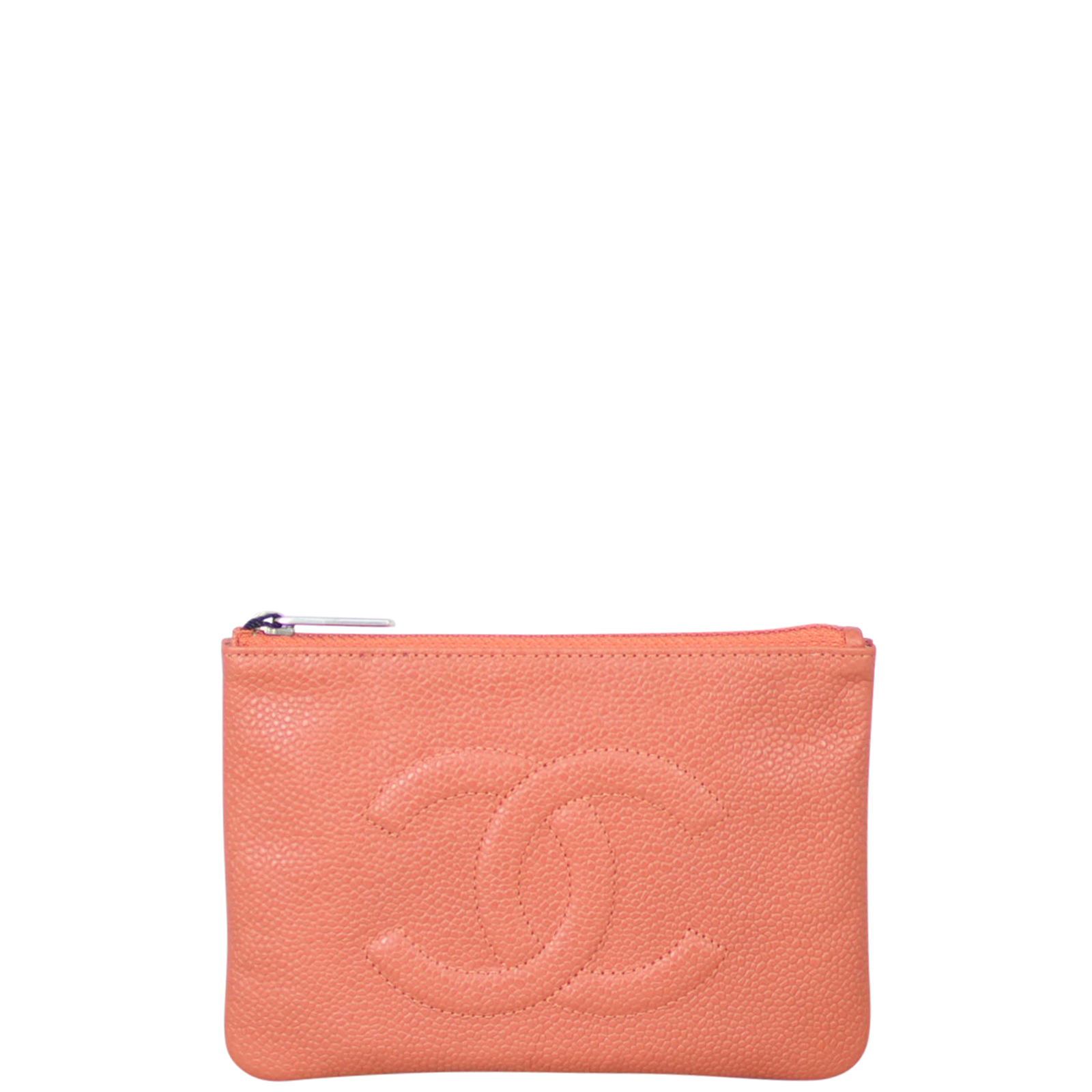 Crafted from supple caviar leather, the Chanel Timeless O-Case Small is a modern, versatile accessory. It can be carried as a clutch for day or evening or slipped inside a larger bag. Featuring the iconic CC logo stitched on the front and in a fresh summery shade, this is the sweetest Chanel around. Features: 'Brique Clair' coral caviar leather exterior; silver tone hardware; top zip closure to main compartment; and silver textile lined interior. Origin: Made in France. Measurements: 15.5 cm (le