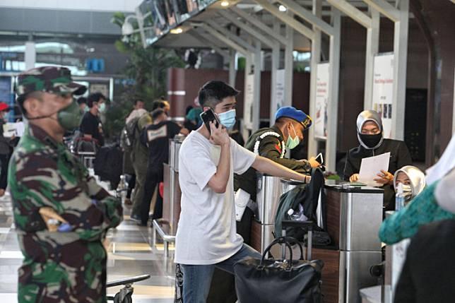A passenger checks in at a counter at Soekarno Hatta International Airport in Tangerang, Banten, on May 7.