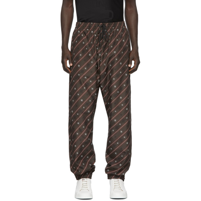 Relaxed-fit technical satin lounge pants in brown featuring logo pattern printed in black and white
