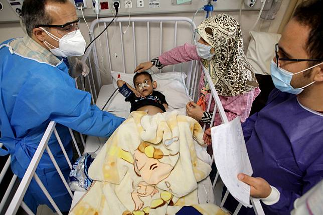 Amirali, a boy suspected to be infected with the coronavirus disease (COVID-19), is treated at Mofid children's hospital, in Tehran, Iran, July 8, 2020.