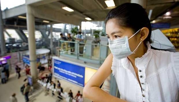 Ilustrasi wanita memakai masker. shutterstock.com