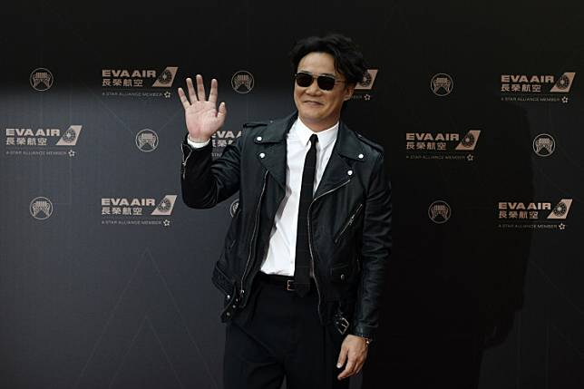 Hong Kong singer Eason Chan gestures upon his arrival for the 30th Golden Melody Awards in Taipei on June 29, 2019.