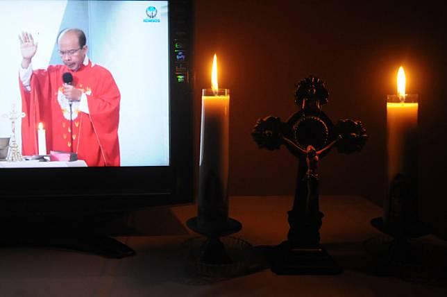 Father Y.R Edy Purwanto, Pr leads an online Palm Sunday Mass in Boyolali, Central Java, on Saturday,