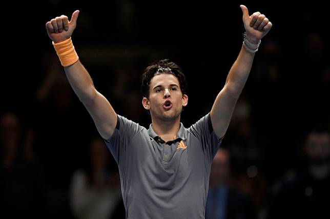 The O2, London, Britain, November 12, 2019 Austria's Dominic Thiem celebrates after winning his group stage match against Serbia's Novak Djokovic Action.