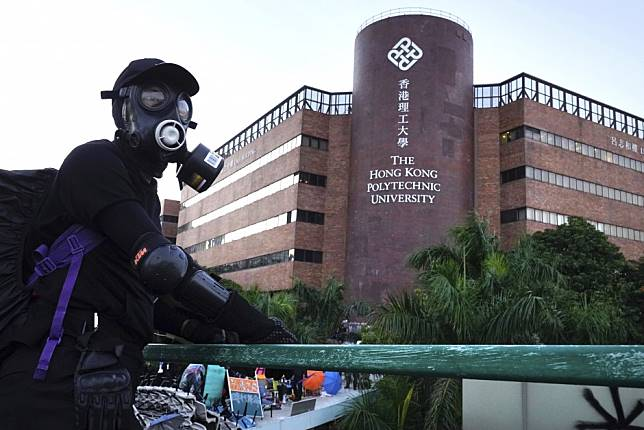 More Hong Kong protesters leave Polytechnic University in surrender, dozens still barricaded inside besieged campus