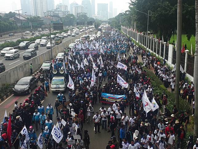 Thousands of people from the Indonesian Worker Union Confederation (KSPI) march in front of the House of Representatives complex in Central Jakarta to protest the omnibus bill on job creation on Monday, Jan 20, 2020.