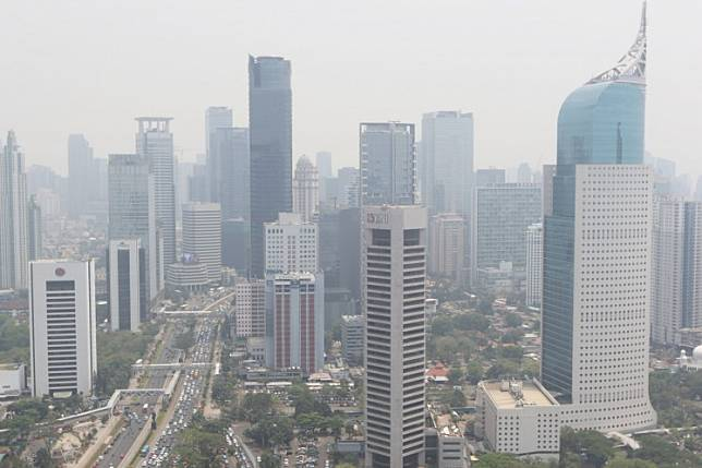 Thick smog blankets high rise buildings in Jakarta's business district of Jl. Sudirman area on Oct. 9, 2019.
