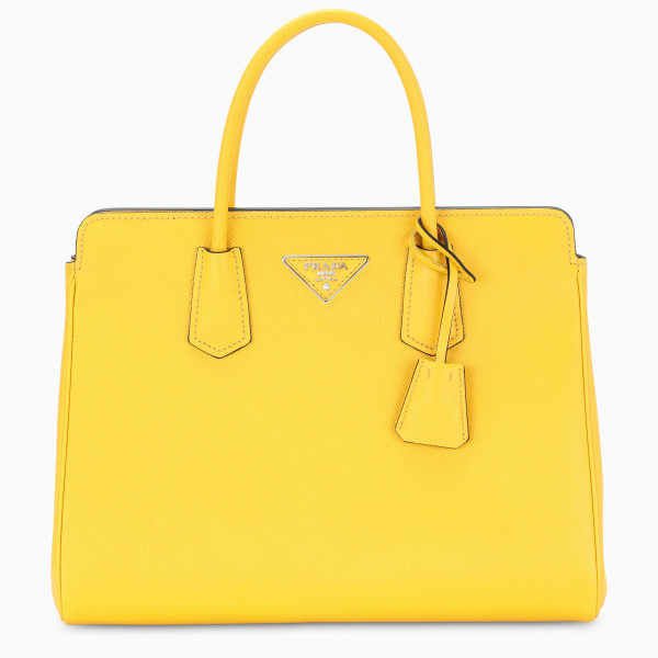 Handbag by Prada in yellow Saffiano leather featuring squared design, two top handles, triangular lo