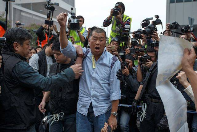 Tycoon and Apple Daily Newspaper owner Jimmy Lai  in this Dec. 11, 2014 file photo. Lai and two other pro-democracy activists were arrested by police on Friday on charges of illegal assembly, local media reported.