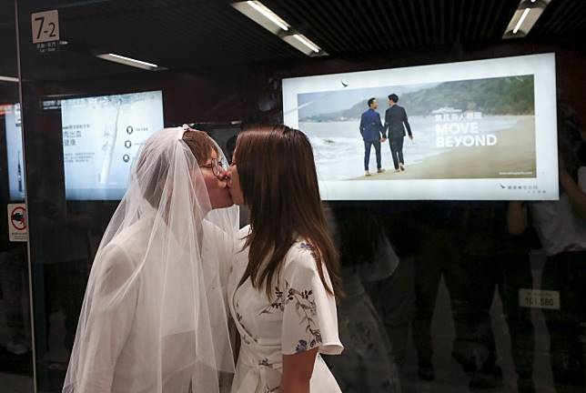 Controversial same-sex advert finally goes on display in Hong Kong as one lawmaker prepares to rail against 'chilling effect' gay rights movement is having on city