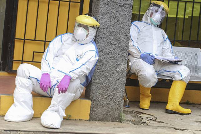 Medical personnel take a rest after conducting COVID-19 swab tests in Depok, West Java, on April 8..