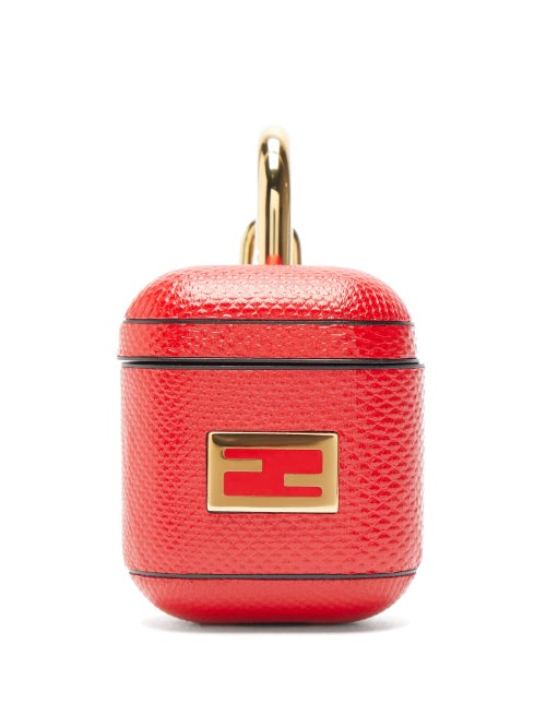 Fendi - Lend a luxe note to your accessories line-up with Fendi's red earphone case. It's Italian-crafted from snakeskin-effect leather then finished with a polished gold-tone metal FF motif to match the logo-engraved metal clasp - ideal for attaching to your belt loop.