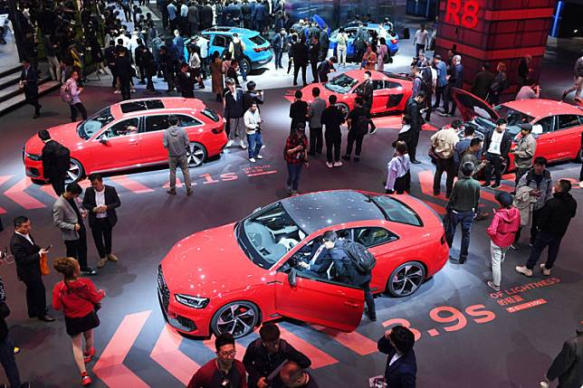 Audis, including the Audi RS5 (bottom), are displayed on the opening day of the Shanghai Auto Show in Shanghai last year.