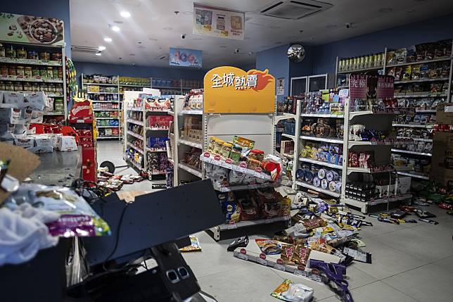 Snacks lie strewn on the floor inside a vandalized Best Mart 360 store, Oct. 6. Photographer: Justin Chin/Bloomberg