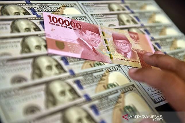 Rupiah menguat dekati Rp14.100, pasar optimis susunan kabinet baru